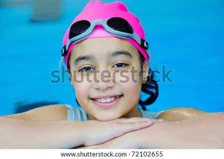 Young girl having good time in the pool - stock photo