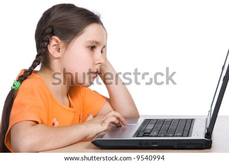 Young girl having with computer game