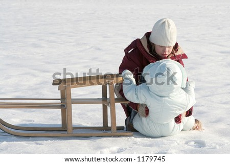 Young girl helping a baby - stock photo