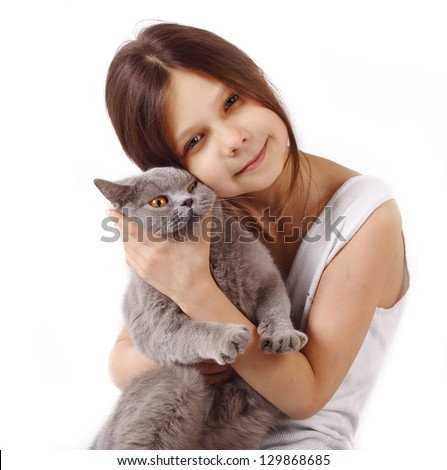 Young girl hold her lovely British cat with blue eye isolated on a white background
