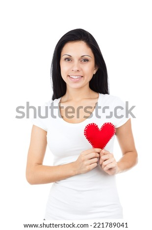 young girl hold red heart, happy woman smile wear shirt isolated over white background, valentine day concept - stock photo