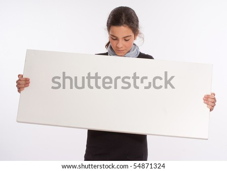 Young girl holding a big horizontal white board, perfect for your customized message - stock photo
