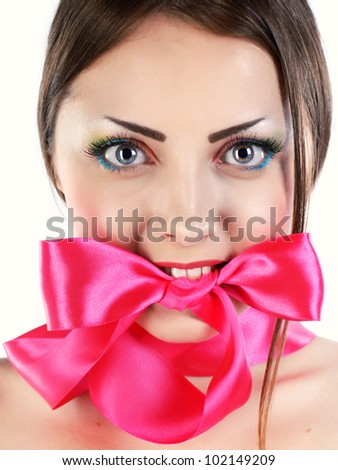 young girl holding a bow in his mouth - stock photo