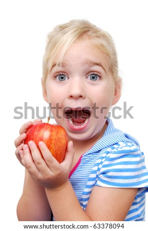 young girl holding apple with a cute expression - stock photo