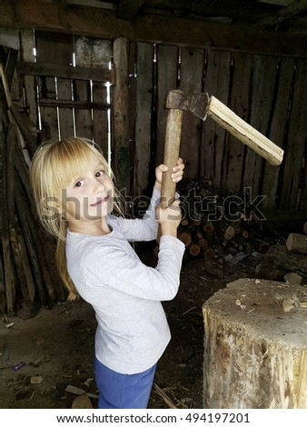 Young girl holding axe