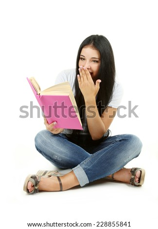 Young girl holding book on white background - stock photo