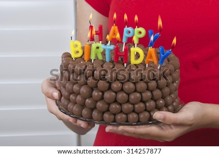 Young Girl Holding Chocolate Birthday Cake Stock Photo 314257877