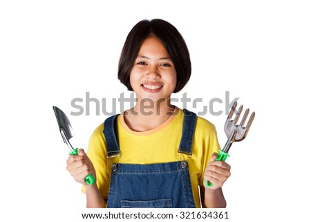 young girl holding garden tool with isolated background - stock photo