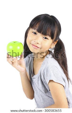Young girl holding green apple - stock photo