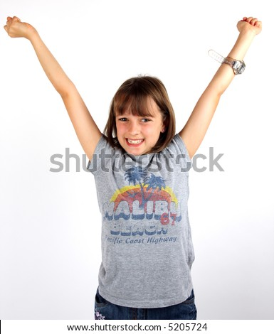 Young girl holding her arms up in celebration
