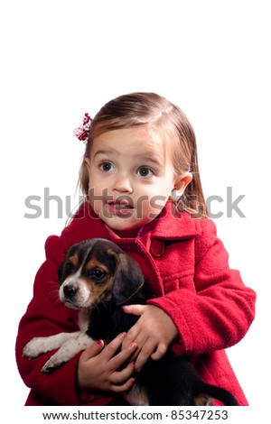 young girl holding her puppy - stock photo