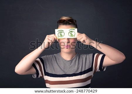 Young girl holding paper with green dollar sign concept - stock photo