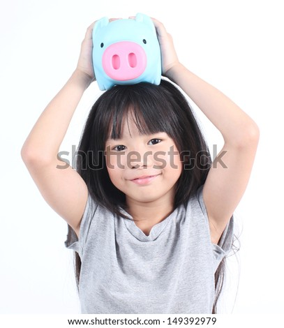 Young girl holding piggy bank  - stock photo