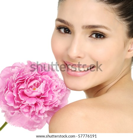 Young girl holding pink  peony flower  in her hands - stock photo