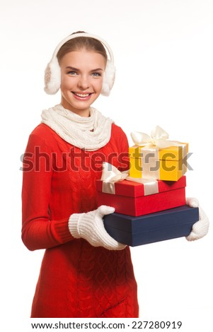 Young girl holding present boxes
