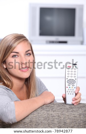 young girl holding remote control - stock photo