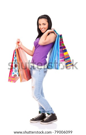 young girl holding shopping bags, isolated on white background - stock photo