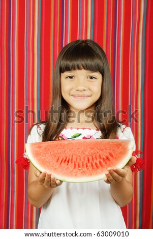 Young girl holding slice of watermelon - stock photo