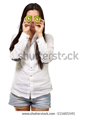 Young girl holding slices of kiwi isolated on white background