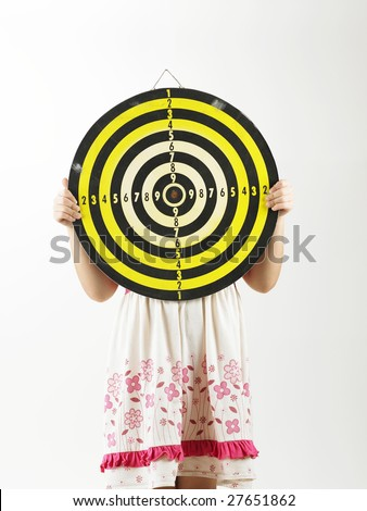 young girl holding target board covering her face