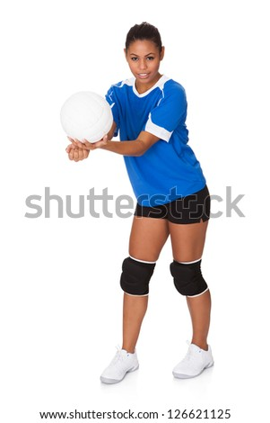 Young Girl Holding Volleyball. Isolated On White - stock photo
