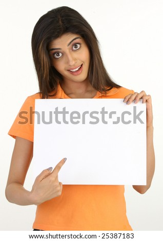 young girl holding white board