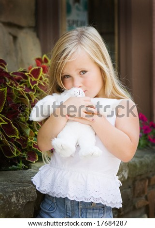 young girl hugging a plush bunny