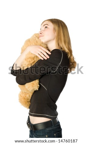 Young girl hugging a Teddy bear, isolated - stock photo