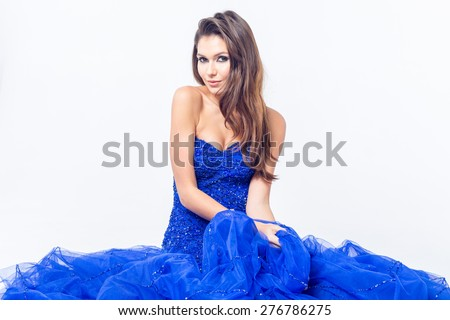 Young girl in a beautiful blue evening dress - stock photo