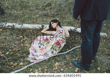 young girl in a bright stylish dress. resting in the Park. walks in nature