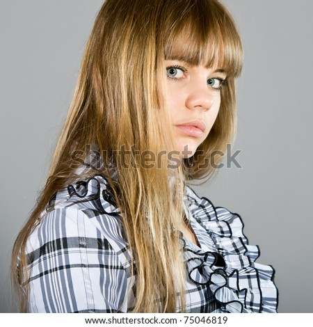 young girl in a checkered shirt