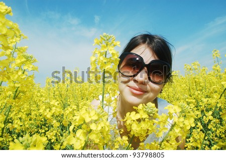 Young girl in a flower field - stock photo