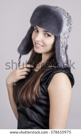 Young girl in a hat. Natural fur Mink. - stock photo