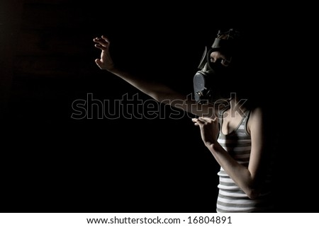 Young girl in a military gas mask - stock photo