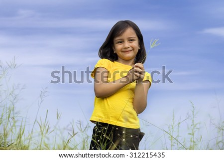 Young girl in a park - stock photo