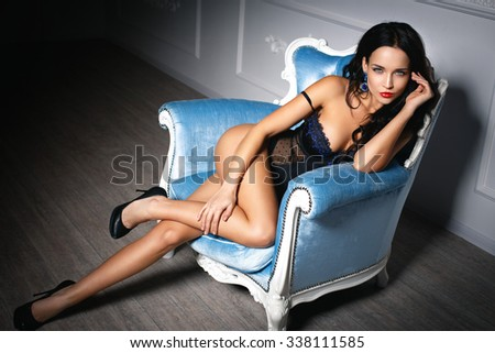 Young girl in a sexy lingerie on the sofa - stock photo