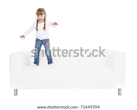 Young girl in a sofa isolated on white background - stock photo
