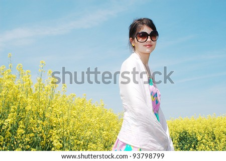 Young girl in a springtime meadow. - stock photo