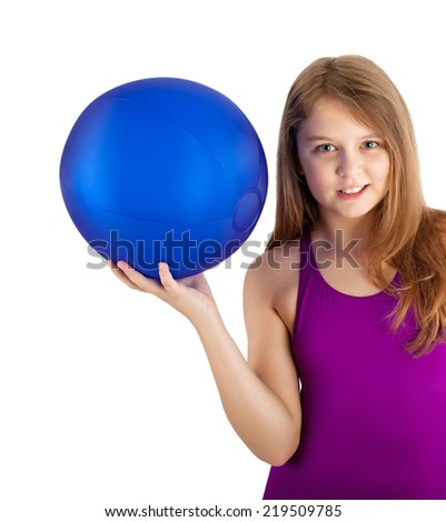 young girl in a swimsuit with a blue water ball - stock photo
