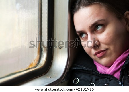 Young girl in a train - stock photo