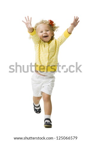 Young girl in a yellow sweater running - stock photo