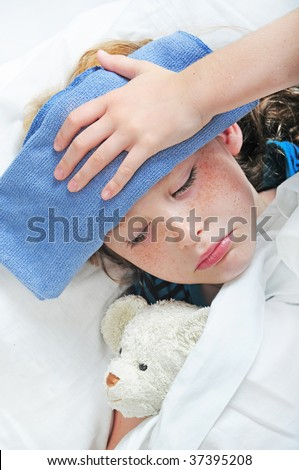 young girl in bed feeling unwell - stock photo