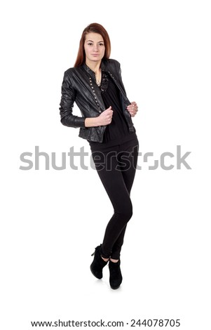 Young girl in black leather jacket and high heels posing isolated over white background - stock photo