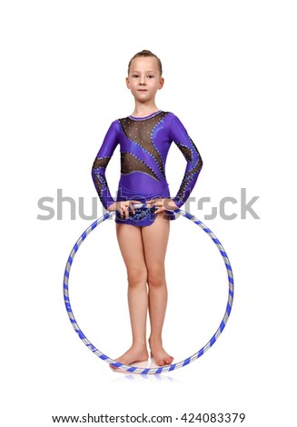 young girl in blue clothes doing gymnastics with hoop - stock photo
