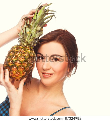Young girl in blue dress with  in her hands pineapple - stock photo