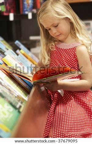 Young girl in bookshop - stock photo
