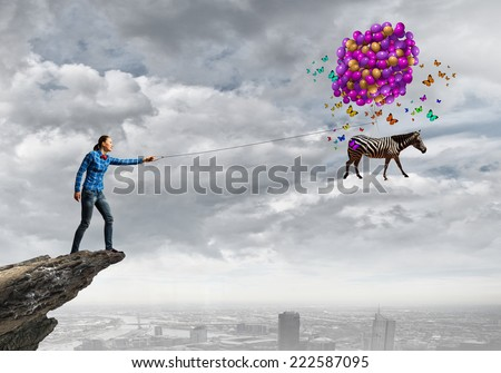 Young girl in casual with bunch of colorful balloons