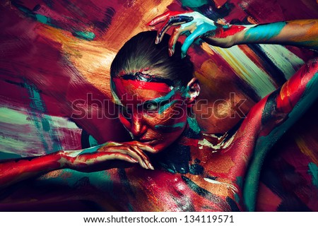 young girl in colourful paint - stock photo