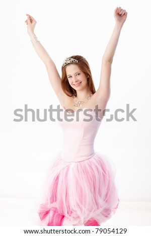 Young girl in coming out dress smiling happily.? - stock photo