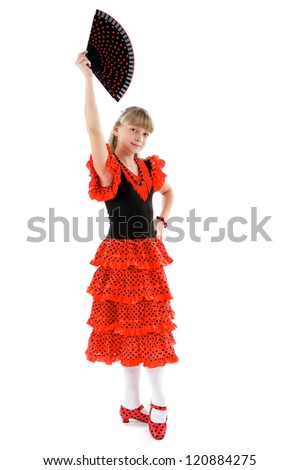 Young Girl in Dance Stance of Flamenco. Traditional Costume and Fan - stock photo